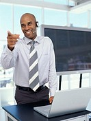 businessman pointing forward at a seminar