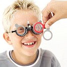 portrait of a young boy getting his eyes tested