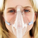 Portrait of a woman wearing a gas mask