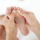 close-up of a masseuses´ hands massaging a foot