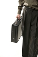 Person carrying briefcase, mid section