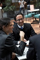 Three business executives having a meeting in a restaurant