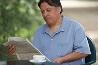 Mature man reading a newspaper