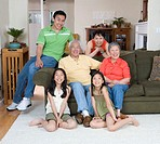 Three generation family sitting in living room