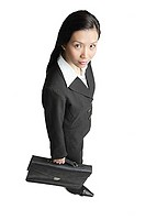 Businesswoman holding briefcase, looking at camera
