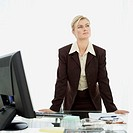 businesswoman standing at a desk