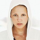 portrait of a young woman wearing a hooded bathrobe