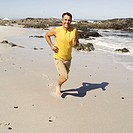 Portrait of a man running at the beach