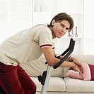 Young man exercising on an exercise bike