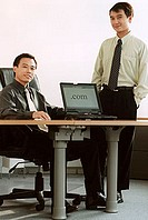 Two male executives with laptop computer.