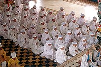 Vietnam, Tay Ninh, believers with white headbands in Cao Dai Great Temple.