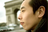 Profile of man, Arc de Triomphe in background.