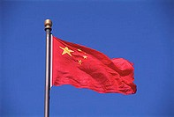 China, Beijing, National flag against blue sky