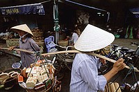 Vietnam, Ho Chi Minh City, District One, Women carrying goods to be sold.