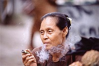 Myanmar (Burma), Yangon (Rangoon), A Burmese woman smoking a homegrown, hand-rolled cigarette called a ´cheroot´.