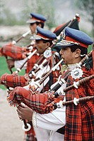 Pakistan, Northern Areas, Hunza Valley, Military band in uniforms playing bagpipes.