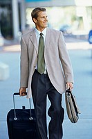 businessman walking with luggage