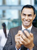 close-up of a businessman holding a hand held device