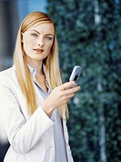 businesswoman holding a mobile phone
