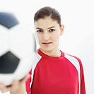 portrait of a young woman holding a soccer ball