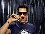 Close-up of a young man singing