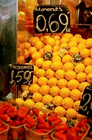 Close-up of strawberries and lemons in a market