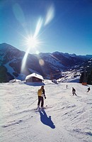 People skiing down hill in saalbach, Austria