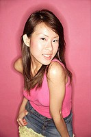 Young woman in pink top, looking at camera