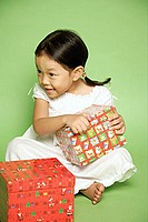 Young girl holding gift wrapped box