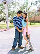 Teenage couple standing together