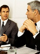 Two businessmen sitting in a restaurant