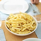 Close-up of a bowl of French fries on a table