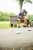 Father and son playing with remote control cars