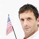 Side profile of a young man holding an American flag