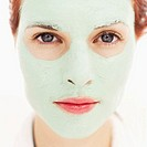 Portrait of a young woman with a face mask on her face