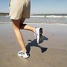 Rear view of a person jogging at the beach