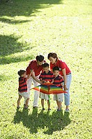 Family with three boys, outdoors with kite