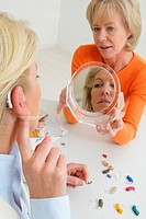 WOMAN CONSULTING FOR HEARING PB.<BR>Models.<BR>Hearing aids.
