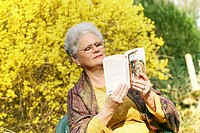 ELDERLY PERSON READING<BR>Model.