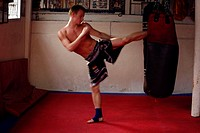 Thai- Boxer from Switzerland during a boxing lesson. Bangkok.Thailand