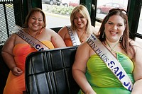 Hispanic females, Miss Latin Plus beauty pageant contestants, overweight. Old San Juan, free trolley. Puerto Rico.