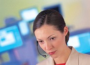 close-up of a woman wearing a telephone headset and working