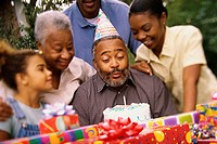 Close-up of three generation family celebrating a birthday