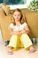 Portrait of a girl sitting on the floor