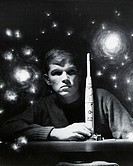 Close-up of a teenage boy holding a model rocket