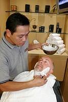 Greenhouse Salon, Asian male shaves White man, cream. MS Noordam. Holland America Line. Puerto Rico, Atlantic Ocean