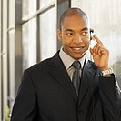 Front view of a businessman using a headset