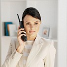 Businesswoman using portable telephone