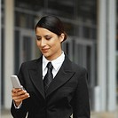Front view of a businesswoman using a mobile phone