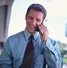portrait of a young businessman talking on a mobile phone